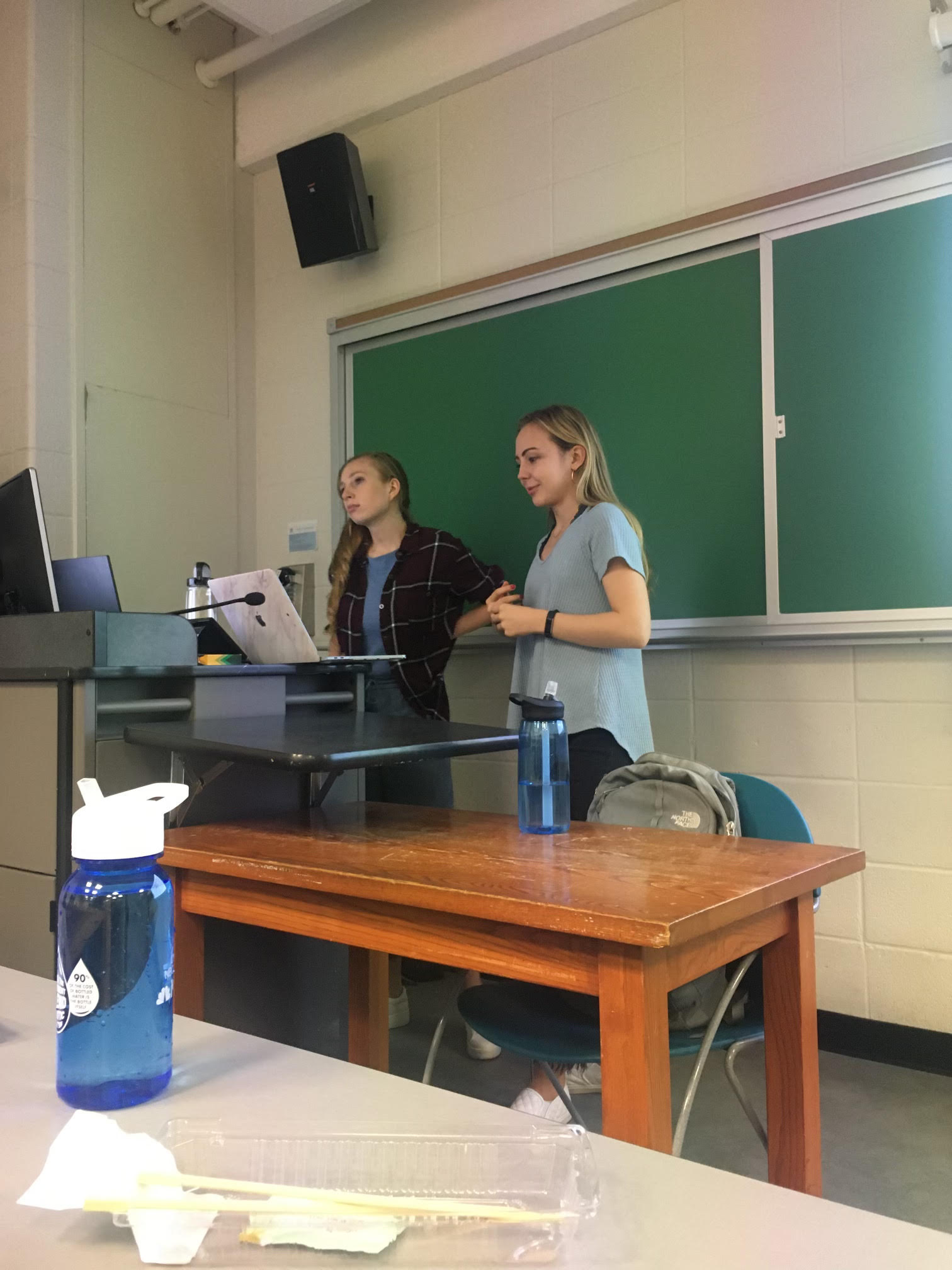 Anastasia Dmitrienko and fellow TA Sophia Kolak giving a midterm recitation for CS Theory.