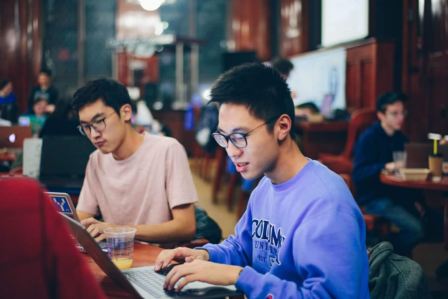 Jin Woo Won and Junyao Shi at the AP hackathon, hacking away as Jae played some music.