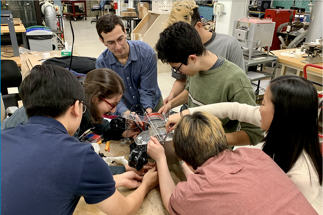 Jonathan Sanabria (center in blue) with other members of the Columbia Robotics Club working on a prototype for an underwater ROV.